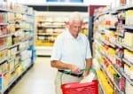 51527248 - senior man buying food at the supermarket